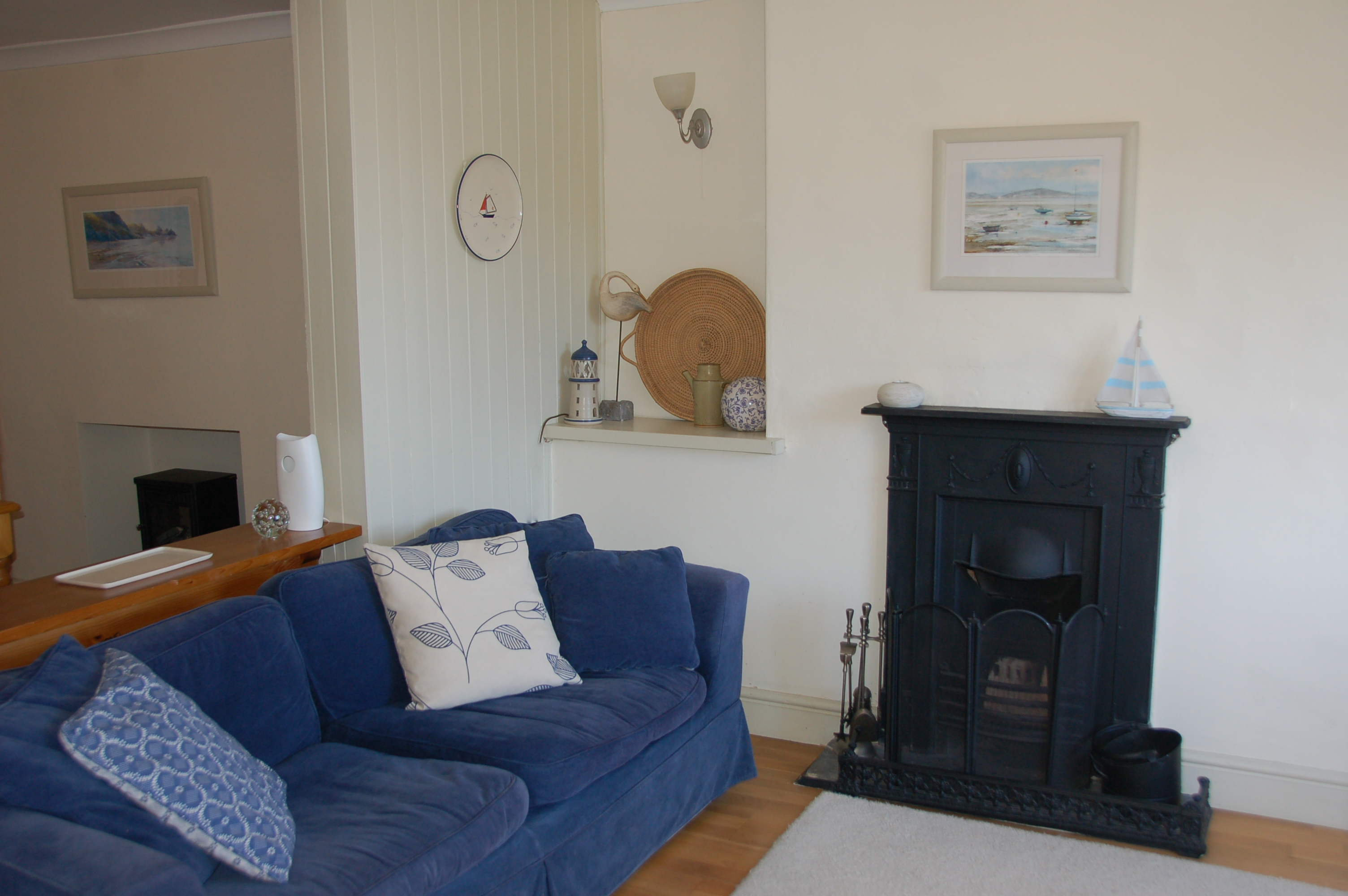 The little fireplace sets off the room;  there are two comfy sofas to flop down in when you come back from a day out
